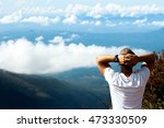 man relaxes on the edge of the... | Shutterstock . vector #473330509
