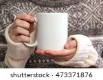 girl in warm sweater is holding ... | Shutterstock . vector #473371876
