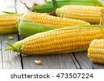 Fresh Corn On Cobs On Wooden...