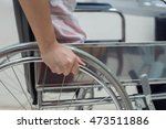 patient in wheelchair | Shutterstock . vector #473511886