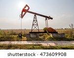 a small private oil derrick... | Shutterstock . vector #473609908