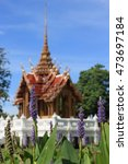 Small photo of Thai castle on the center of lake and flower all around