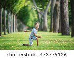 Boy Playing With Toy Glider In...