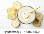 glass of banana smoothie on... | Shutterstock . vector #473834560