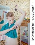 young handsome man applying... | Shutterstock . vector #473929054