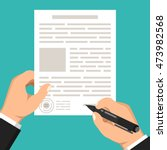 hand holds document and other...   Shutterstock .eps vector #473982568