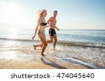 young  couple having fun on... | Shutterstock . vector #474045640