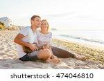 happy couple playing ukulele on ... | Shutterstock . vector #474046810