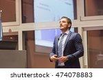 speaker giving talk on podium... | Shutterstock . vector #474078883