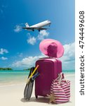 suitcase and big straw hat on... | Shutterstock . vector #474449608