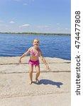 dancing girl on the riverbank... | Shutterstock . vector #474477808