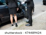 male chauffeur opening the car... | Shutterstock . vector #474489424