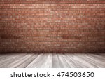 Red Brick Wall And Wooden Floo...
