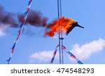 High Diver Performing A Fire...