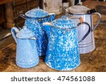 Small photo of Antique graniteware, speckleware, enamelware, agateware, coffee pots. Four pots in all. Two cobalt blue and white swirl, one grey and white mottled one light blue and white speckled.