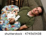 a newborn baby is curled up... | Shutterstock . vector #474565438