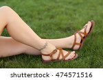 female legs with tattoos on... | Shutterstock . vector #474571516
