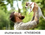 Man With Cute Dog In Spring Park