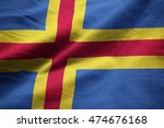 Small photo of ?Closeup of Ruffled Aland Flag, Aland Flag Blowing in Wind