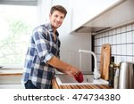 happy young man in plaid shirt... | Shutterstock . vector #474734380
