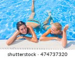 two women at the swimming pool | Shutterstock . vector #474737320