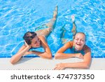 two women at the swimming pool | Shutterstock . vector #474737350