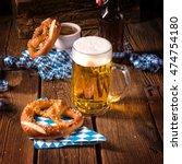 oktoberfest pretzel and beer   Shutterstock . vector #474754180