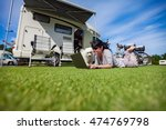 woman on the grass with a dog... | Shutterstock . vector #474769798