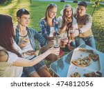 cheerful friends on picnic in... | Shutterstock . vector #474812056