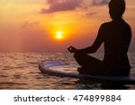 woman practicing sup yoga at... | Shutterstock . vector #474899884