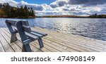 bench view by water edge | Shutterstock . vector #474908149