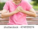 woman has chest pain in the... | Shutterstock . vector #474959074