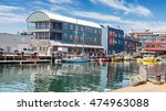 Small photo of Water taxis and boats on the busy Maine Wharf, Portland, Maine