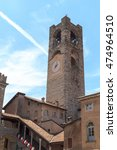 Small photo of Old city tower Torre Civica in Bergamo, Citta Alta, Italy