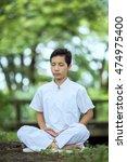 male asian buddhist meditation...   Shutterstock . vector #474975400