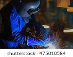 worker is welding automotive... | Shutterstock . vector #475010584