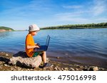boy sitting on the beach with a ... | Shutterstock . vector #475016998