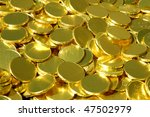 Pile of unidentifiable blank gold coins - stock photo