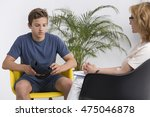 young boy talking with a... | Shutterstock . vector #475046878