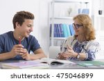 mature teacher giving private... | Shutterstock . vector #475046899