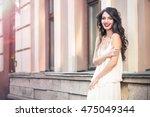 beautiful girl on white dress...   Shutterstock . vector #475049344
