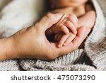 newborn baby hand holding... | Shutterstock . vector #475073290