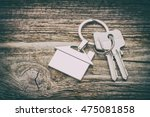 house key on a house shaped... | Shutterstock . vector #475081858