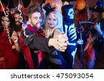 people dancing at halloween... | Shutterstock . vector #475093054