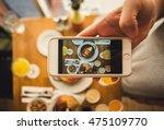 women hold a smart phone in a... | Shutterstock . vector #475109770
