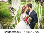 bride and groom outdoors.... | Shutterstock . vector #475142728