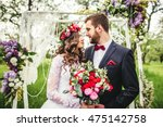 bride and groom outdoors.... | Shutterstock . vector #475142758