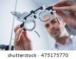 close up of optometrist holding ... | Shutterstock . vector #475175770