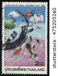 Small photo of RUSSIA KALININGRAD, 31 MAY 2016: stamp printed by Thailand, shows children's drawing of kids with kites afield, circa 1998