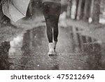 feet in rubber boots rain... | Shutterstock . vector #475212694